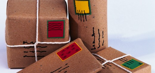 Pile of four parcels wrapped in brown paper and string